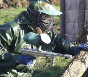 Paintballer readying herself for a run to grab the flag