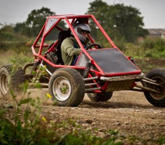 testing the grip by taking a tough corner at speed in a rage buggy