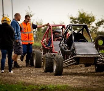 Max events instructors talking to clients at the end of their rage buggy experience