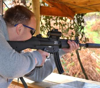 Stag taking aim with the MP5 rimfire