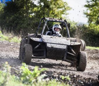 Mud flying on Rebel buggy track