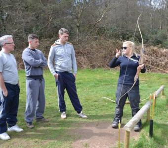Stag party receiving archery briefing by instructor at Max Events