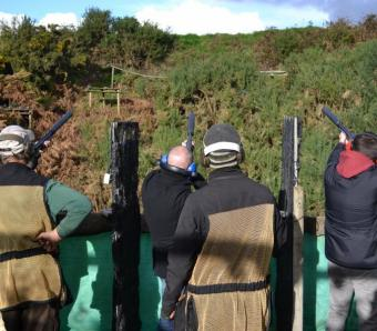 3 stags shooting clays with pump action Mossberg shotguns
