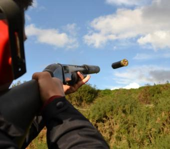 Shotgun Cartridge being expelled out of pump action on stag do clay pigeon shoot