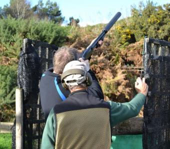 Stag do member shooting clays with a Mossberg pump action