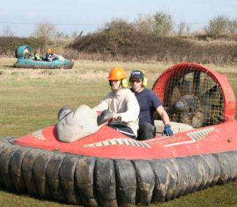 stag party members and instructors in hovercrafts