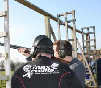 Clay shooter getting instruction at max events Bristol