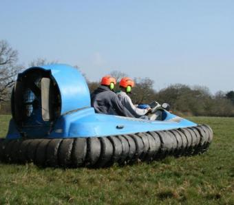two lads enjoying hovercrafts on an activity day at max events