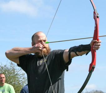 Viking warrior trying his hand at Archery before pillaging Oxford city