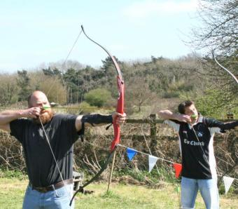 archers taking aim at the course line