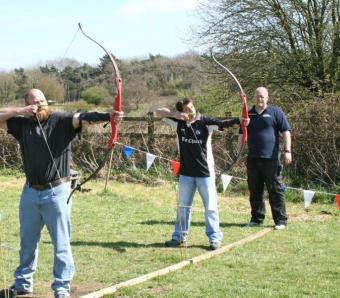 Two Archers on stag do about to unleash the wrath of arrows onto the target