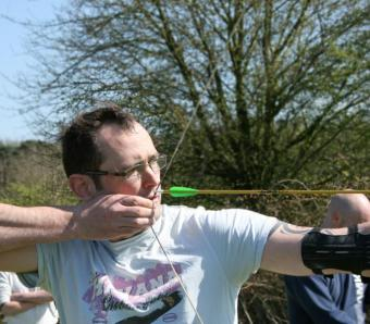 Archer with arm guard about to release arrow