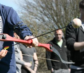 Loading the ball tipped arrow into the bow on Clay Archery