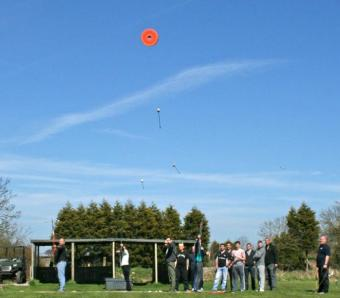 Clay archery arrows flying towards their target