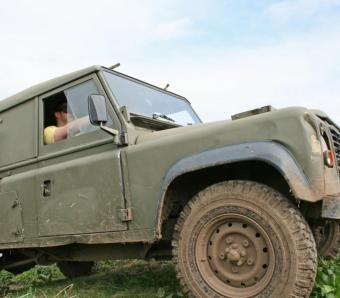 Stag party blind driving in a old military land rover