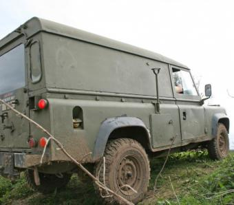 Landrover taking on a hill for a stag party enjoying the blind driving activity