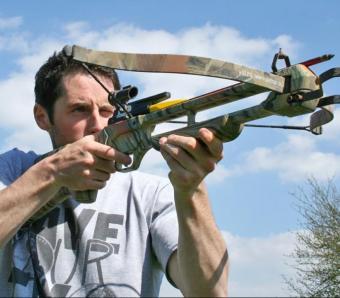 Taking aim through the crossbow sight
