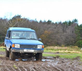 Navigating some a muddy off road course in the blind driving range rover