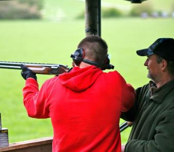 Stag party member getting clay pigeon instruction