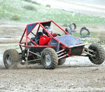 Kicking up dust and raising a wheel in a rage buggy!