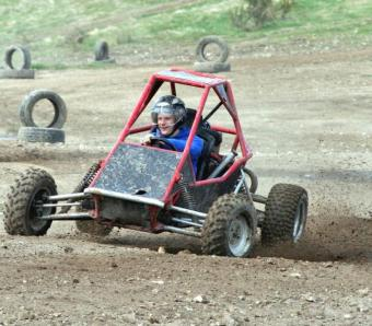 Happy stag do member enjoying the thrill of rage buggies