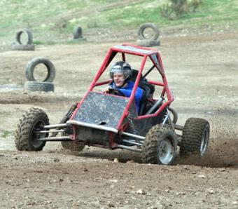 the stag enjoying driving the infamous rage buggy at max events