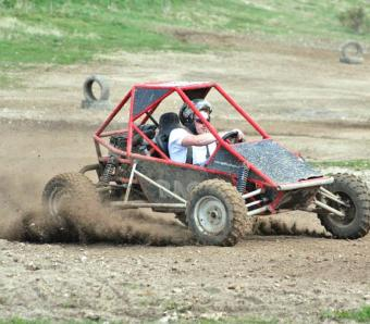 stag do kicking up some dust on a rage buggy