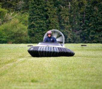 Stag do leaning low to take corner in Hovercraft