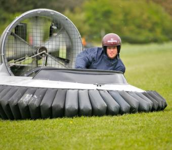 Laughing stag party member in hovercraft