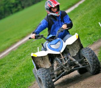 Stag party member taking corner on Quad Bike