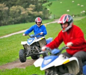 Quad Bikers navigating the off road course on stag do
