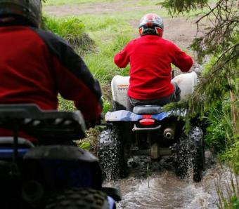 Stags on Quad Bike safari navigating river crossing