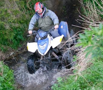Making a splash crossing a stream on a Quad Bike