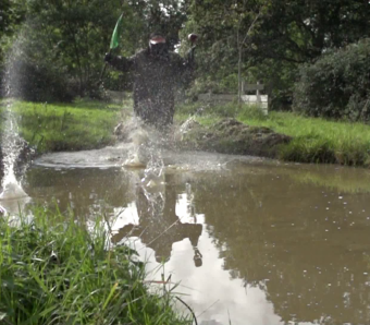 Stag running through pond with oppositions flag